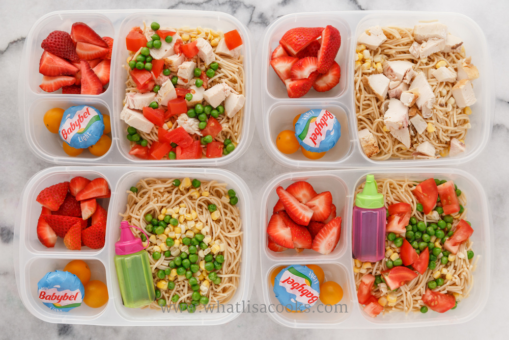 Leftover cold noodles with sesame oil and soy sauce, with different combinations of peas, corn, tomatoes, and chicken, depending on what each child likes.  Two have soy sauce on the side.  They all have tomatoes, cheese, and strawberries. Packed in  Easy Lunchboxes brights , with  Sauce Bottles .
