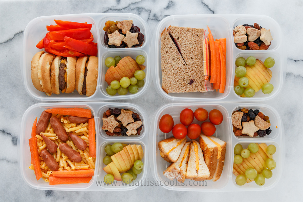 Cleaning out the fridge for lunch - a little bit of everything! One has a cheeseburger and sweet peppers, one has mac & cheese with hot dogs and carrots, one has a grilled cheese sandwich with tomatoes, one has a sunbutter & jam with carrots and a cheese. On the side they all have apples, grapes, cookies, dried fruit, and nuts.