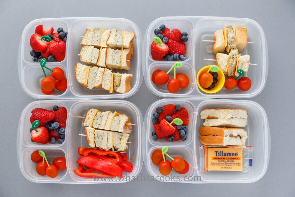 Turkey burgers on sweet Hawaiian rolls with cheddar cheese (one who doesn't eat meat has sun butter & jam, with cheese on the side).  With tomatoes, strawberries, blueberries, and one has some sweet peppers. Packed in  Easy Lunchboxes , with  leaf picks .