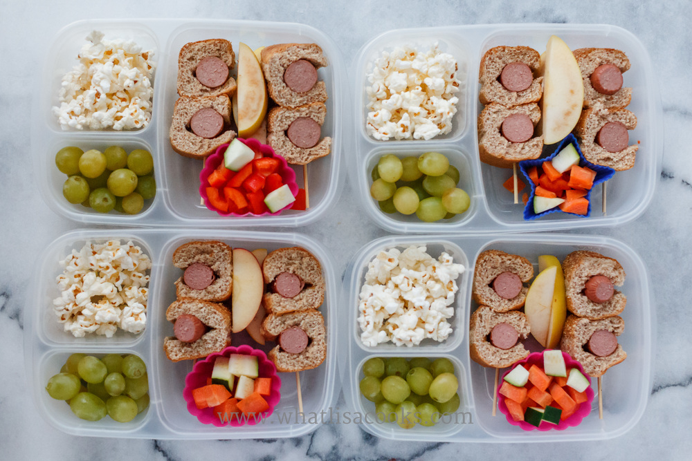 Hot dogs (Applegate brand, no artificial stuff!) on whole wheat buns, zucchini and carrots, popcorn, grapes.