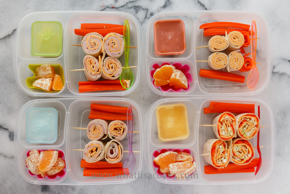 Pinwheels: tortillas rolled with cheese, two have ham, one has peppers, carrots and cabbage. They have carrots and oranges on the side, and one has sour cream, one has cottage cheese, one has yogurt with honey, one has sunbutter.