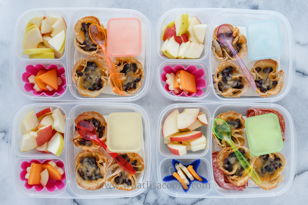 Mini taco cups: just corn tortillas, toasted in a muffin tin, filled with black beans and melted cheese, with sour cream for dipping, apples, and cheese.