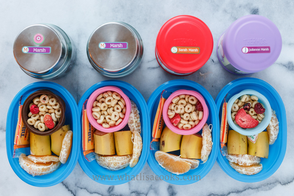 O's cereal with dried berries, banana, orange, cheese.  In the thermos containers is homemade instant oatmeal.  I pack hot foods in  these Thermos Funtainer Food Jars.