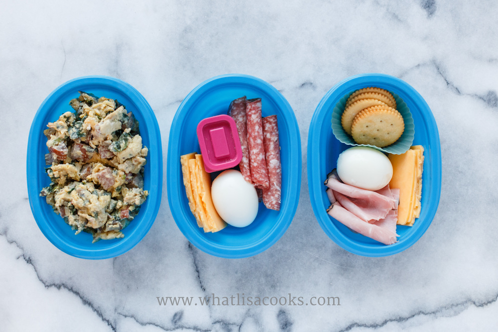 This was a breakfast and snack. My breakfast doesn't look very appealing here, but it was really good. Scrambled eggs with polish sausage, spinach, mushrooms, onions, and cheese. In the middle was my lunch - salami, boiled egg, cheese, and salt for the egg in the pink container. On the right was a mid-morning snack for my son - ham, cheese, egg, and crackers.