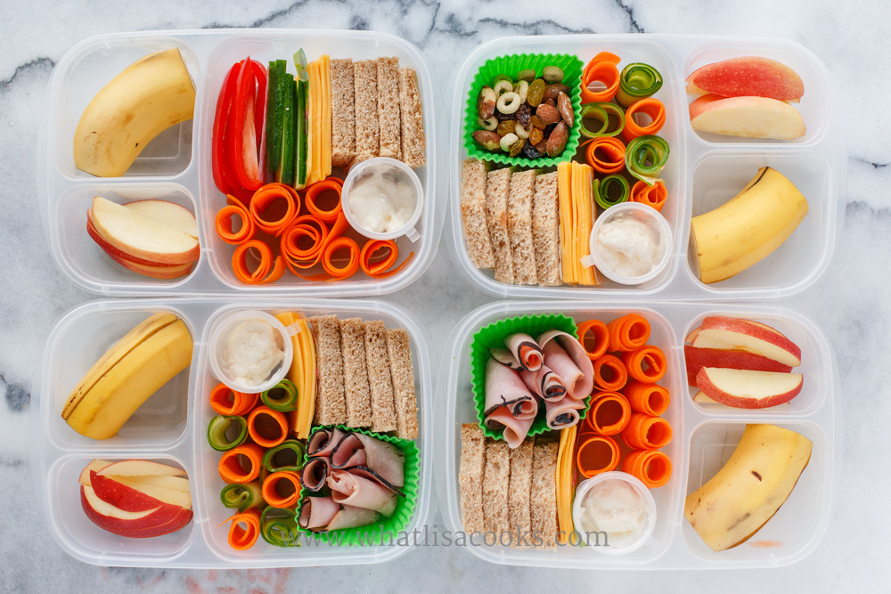 One of my favorite lunches! I just think it's so pretty! This is a make your own sandwich kit. Slices of bread, cheese ham, and veggies, with mayo. The kids came home from school very proud to tell me that they made their sandwiches. On the side they have apples and banana, and one has some trail mix.