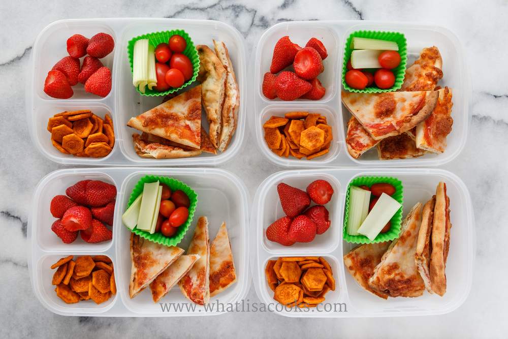 Easy homemade cheese pizzas made on frozen naan bread, with tomatoes, celery, strawberries, and crackers. Packed in  Easy Lunchboxes , with  silicon muffin cups .