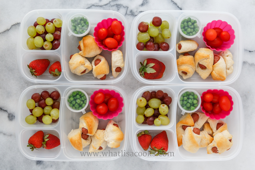 Pigs in a blanket, tomatoes, peas, grapes, strawberries.Packed in Easy Lunchboxes .