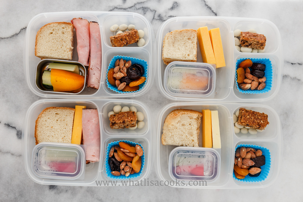 homemade bread, cheese, veggies, nuts, dried fruit, homemade granola bar. Packed in  EasyLunchboxes , with  silicone muffin  cups.