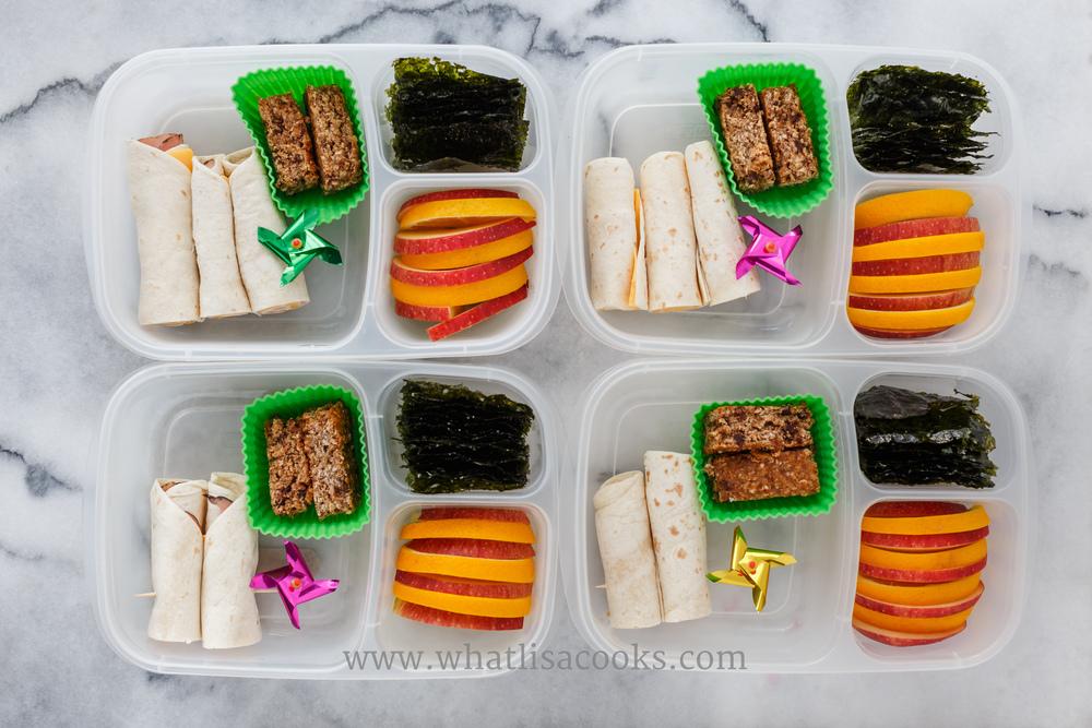Rolled quesadilla, apples, seaweed snacks, granola bar.