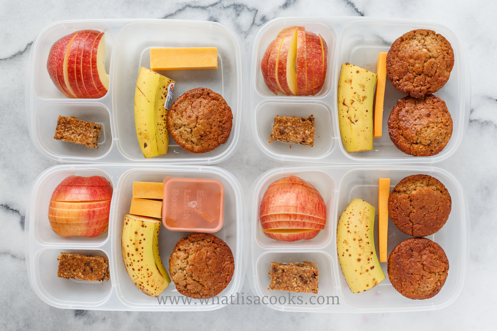 Homemade banana muffins, cheese, banana, apples, granola bar, and one has a little peanut butter. Packed in  EasyLunchboxes , with a  Mini Dipper container  for the peanut butter.