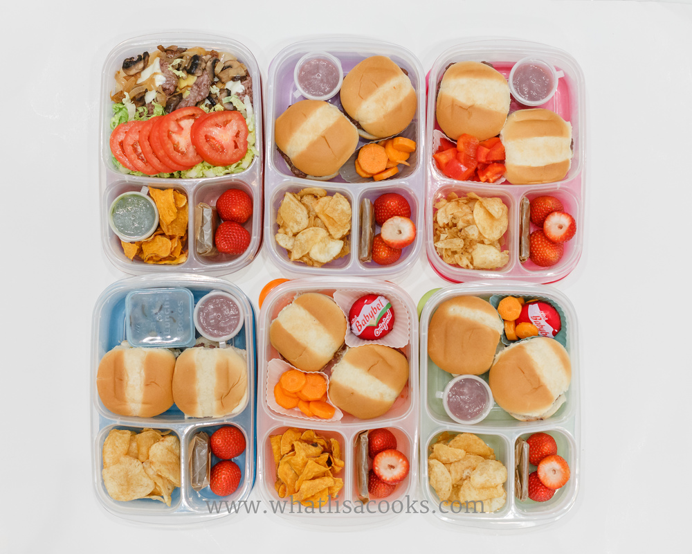 6 lunches packed at once, in pretty quick order while cleaning up from dinner. Dad and kids have burgers, carrots, cheese, chips and strawberries.  Mine is a quick salad with a hamburger patty, mushrooms, tomatoes, and sweet potato chips.