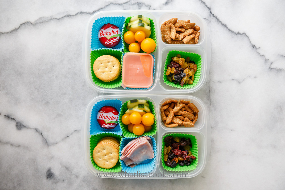 """lunchable"" with crackers, veggies, cheese."