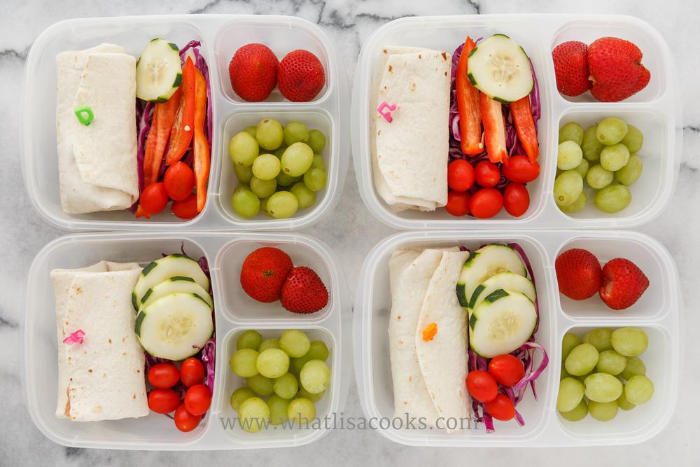 Burrito with veggies and fruit.