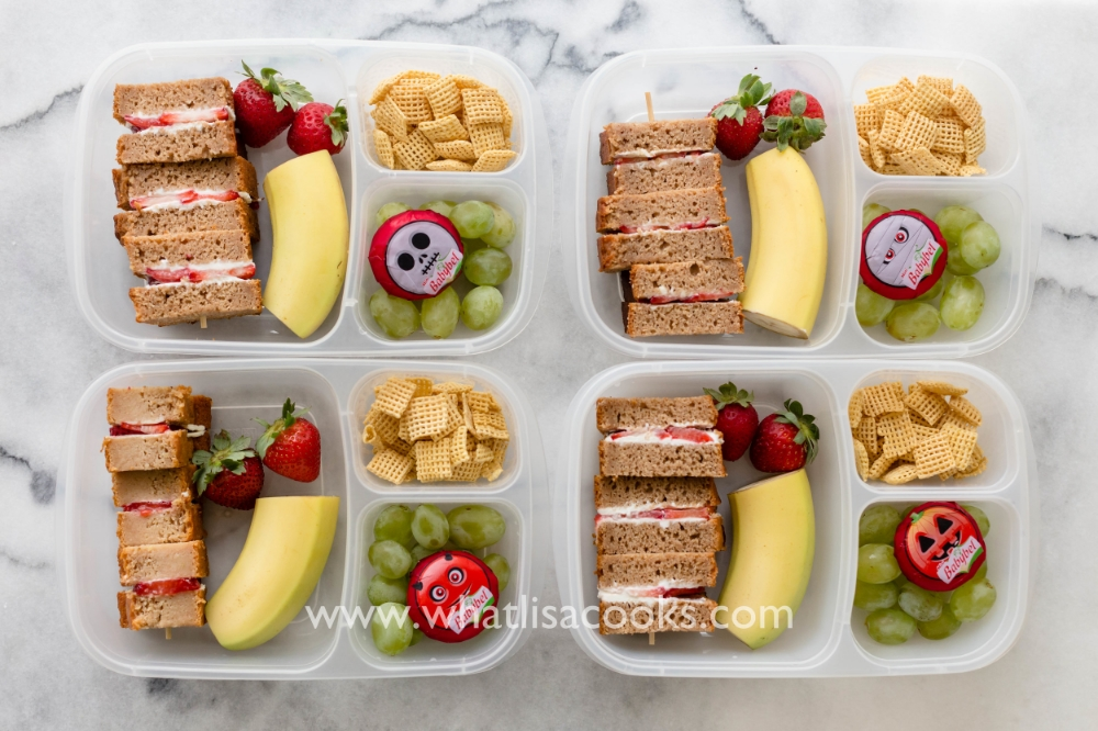 Strawberry & cream cheese sandwiches on apple bread.