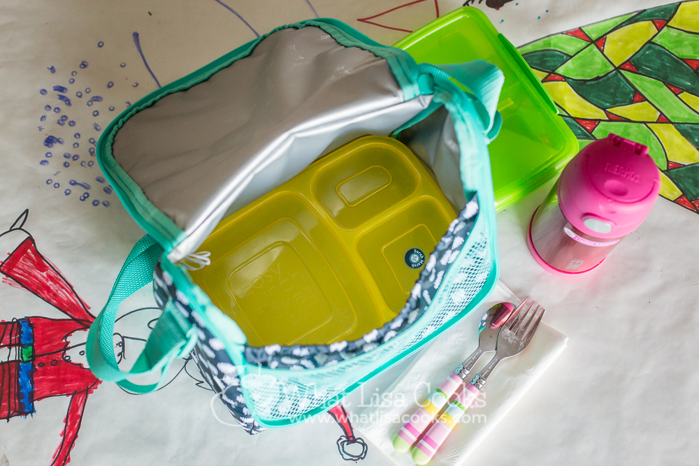 The inside holds our favorite lunch container - EasyLunchbox - perfectly. It fits just right and stays flat.