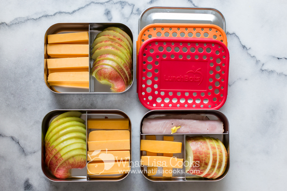 snack box with ham, cheddar cheese and apples.