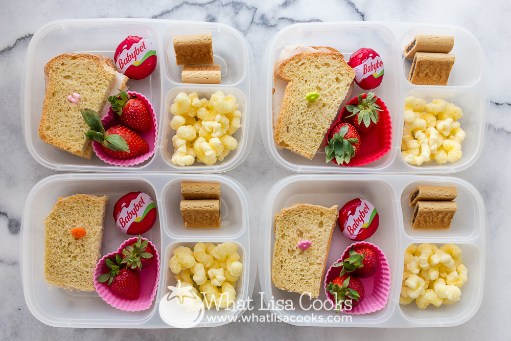 Simple sandwiches with colorful strawberries.