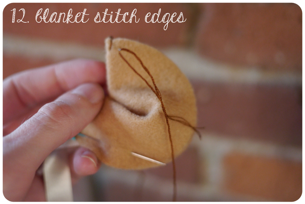 Starting at one side of the fold, Blanket stitch the 2 layers together until you get about 1 inch from the other side of the fold.
