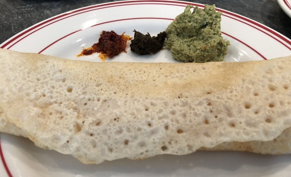 Dosa with Pickles and Chutneys, in attendance:  Top Row: Tomato Pickle , Mint Chutney, Coconut Chutney Front Row: The Dosa