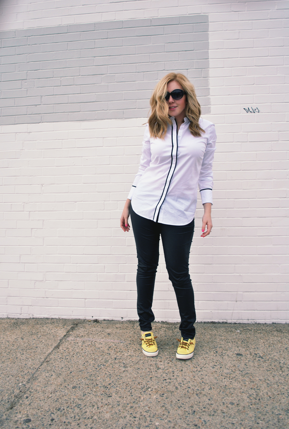jumping for joy | thoughtfulwish // leather pants // ann taylor // white shirt // leather jacket // yellow sperrys