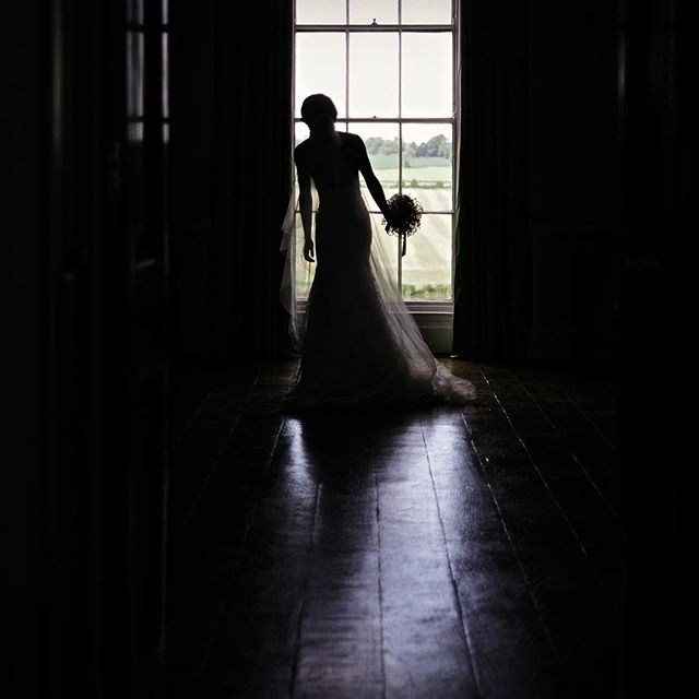 It's a bit of a classic but I rather like it #unposed Tamara in the window at #kelmarshhall with #fujifilmxpro1 #weddingphotography #weedingdress #fujifilm