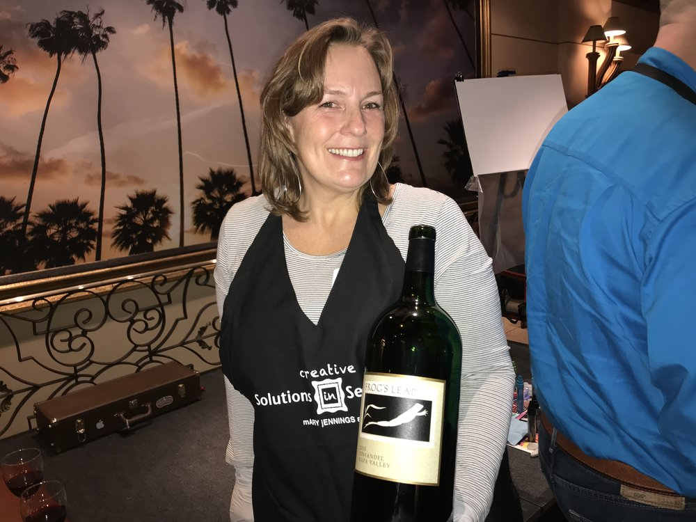 Mary holding Frog's Leap Zinfandel wine.