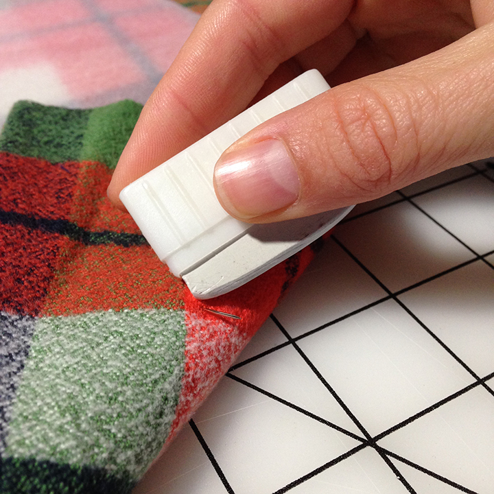 Flip the piece over and mark where the same pin exits the fabric.