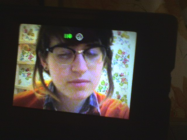 More college earthtone selfies. Here's a clip from a video piece featuring a fantastic orange sweater.