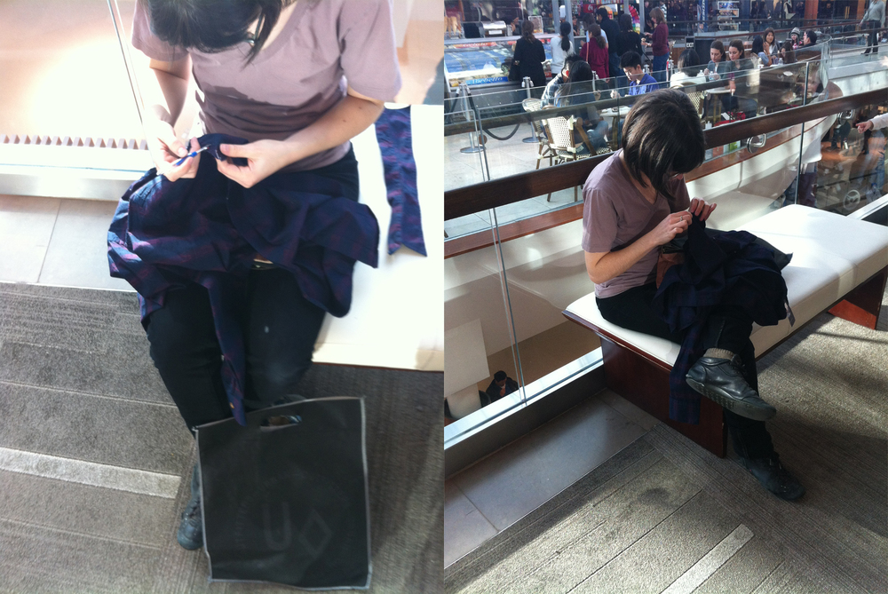 Black Friday,  Nov   2012: After purchasing a shirt at Urban Outfitters, I took apart the shirt with a seam ripper and re-sewed the shirt by hand while sitting on a bench across from the store.