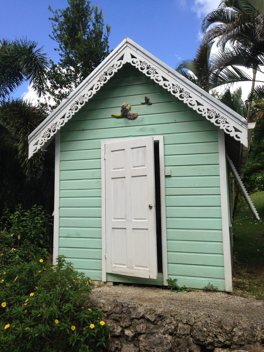 A tiny building with scroll work in Barbados