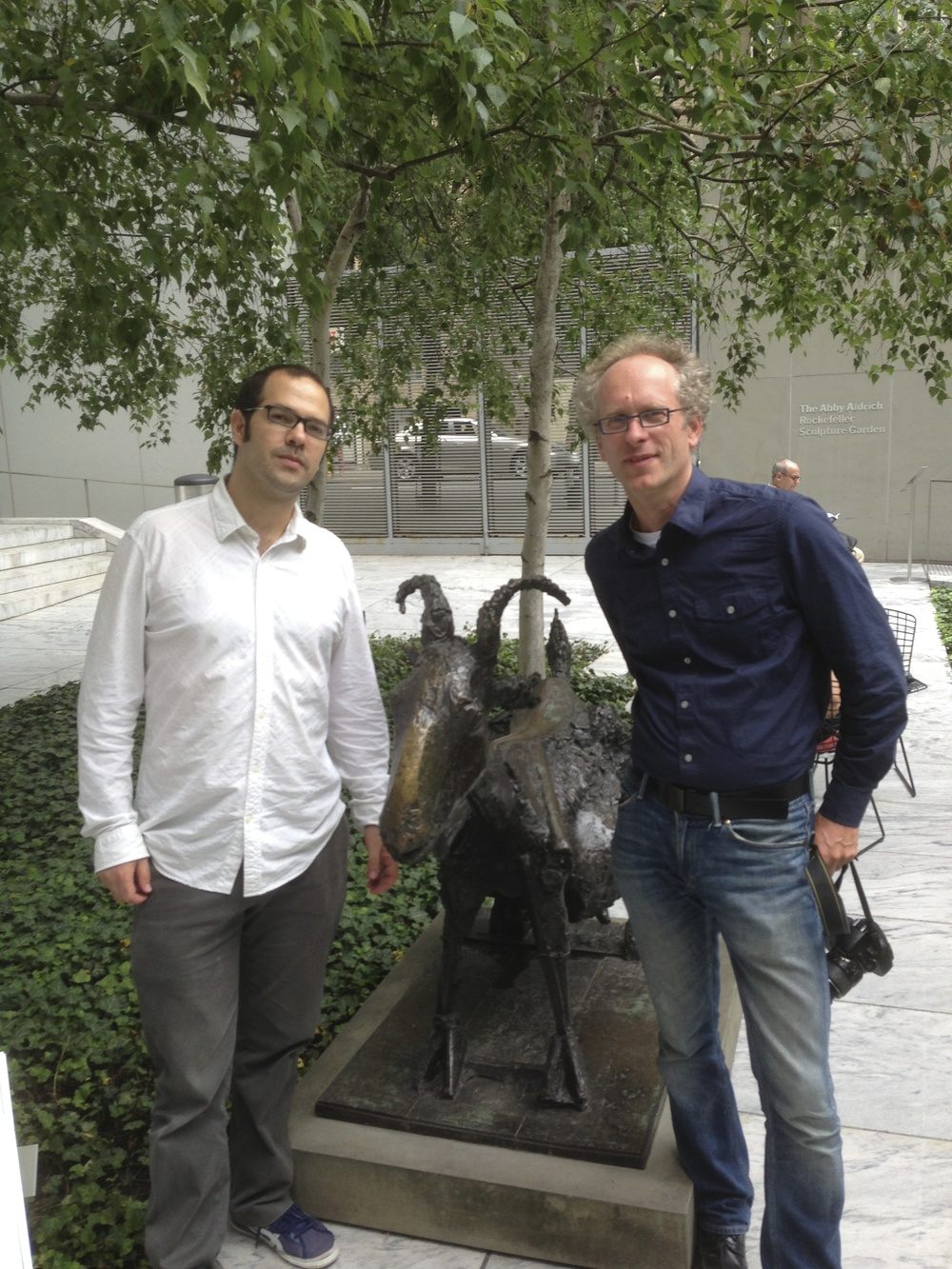 Both authors in front of a Picasso goat sculpture.