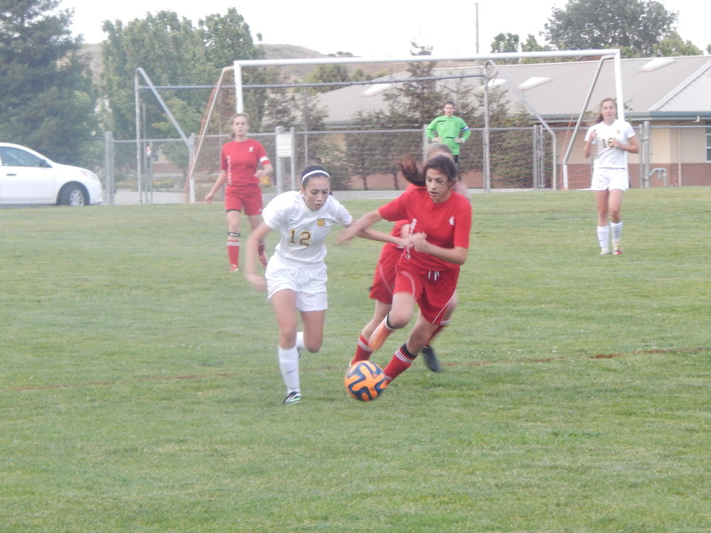 Michaela Bodie fighting for the ball with a Victory Christian player