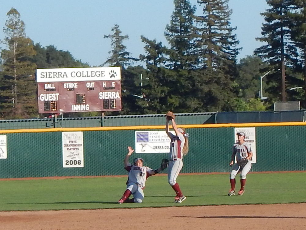 From Left to Right:  Lexi Wagoner, Kasie Trezona, and Halie Howell on an out in the outfield