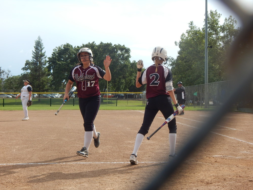 Courtney Bell and Rebecca Bernard high five after Bell scores Thursday ( Jeremy McDonald 65 Sports)