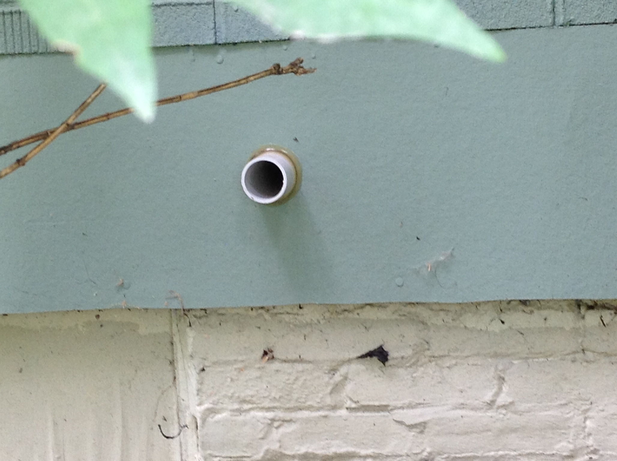 This little vent pipe replaces the crumbling brick chimney because the 95% efficient furnace vents cooler air.