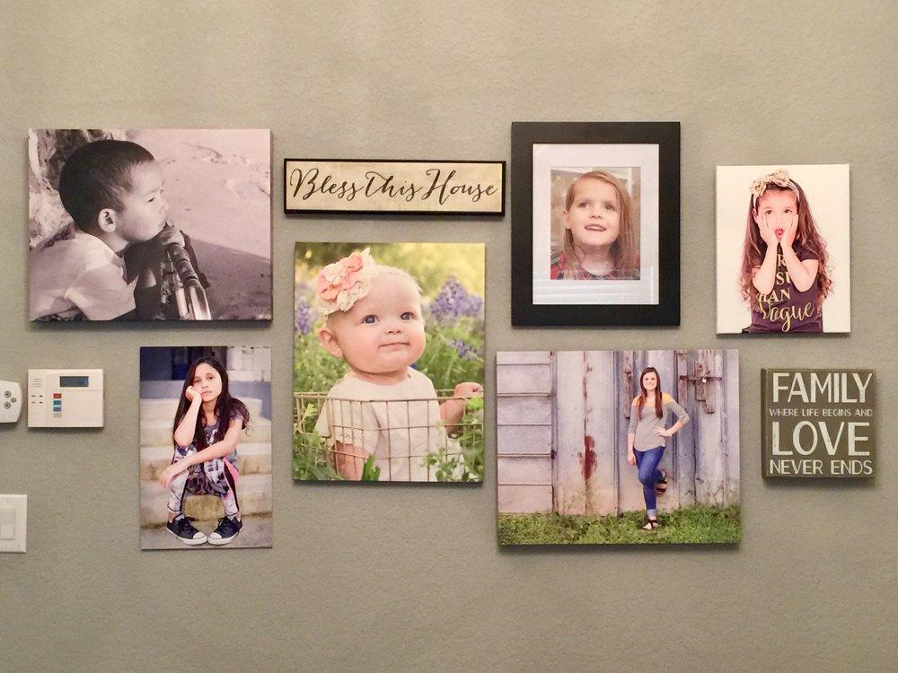 My grandchildren's photos grace my bedroom wall.