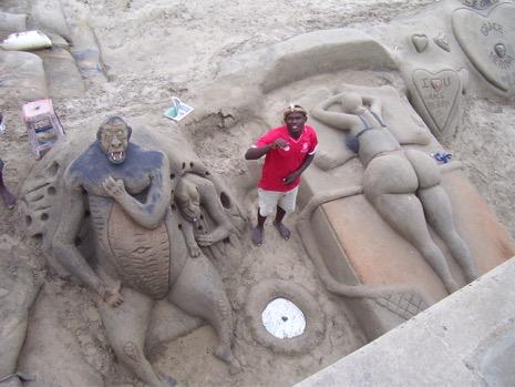 Not even the sand sculptors can resist a kardashian backside.