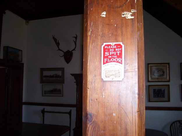 an abundance of signs throughout the town, imploring guests to refrain from spitting