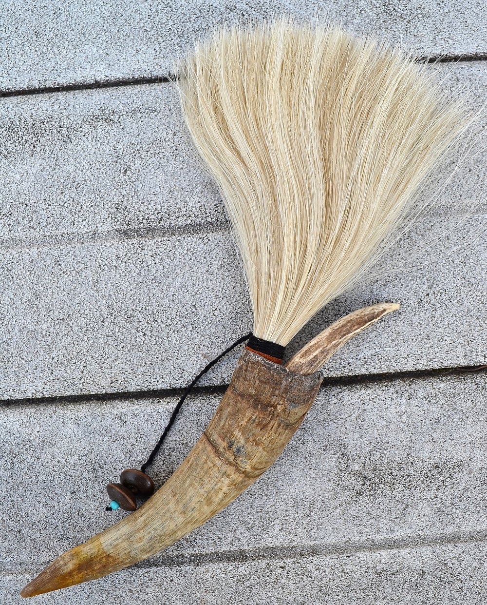 Goat horn, horse hair, twine, leather, antler tip, turquoise and woodenbeads.  Artist made primal brush for use or display