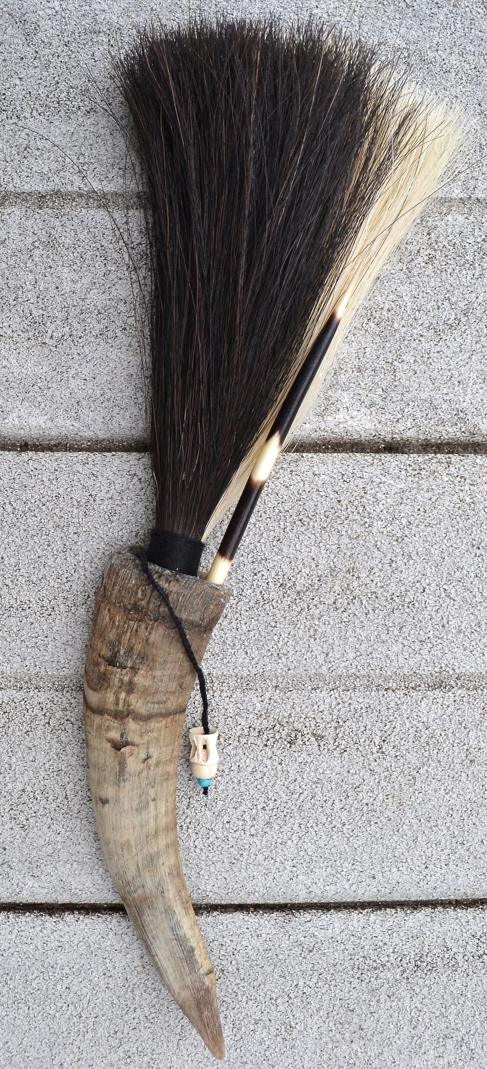 Goat horn, horse hair (black and white), twine, porcupine quill, turquoise bead, wooden bead and Shark vertebrae.  Artist made primal brush for use or display
