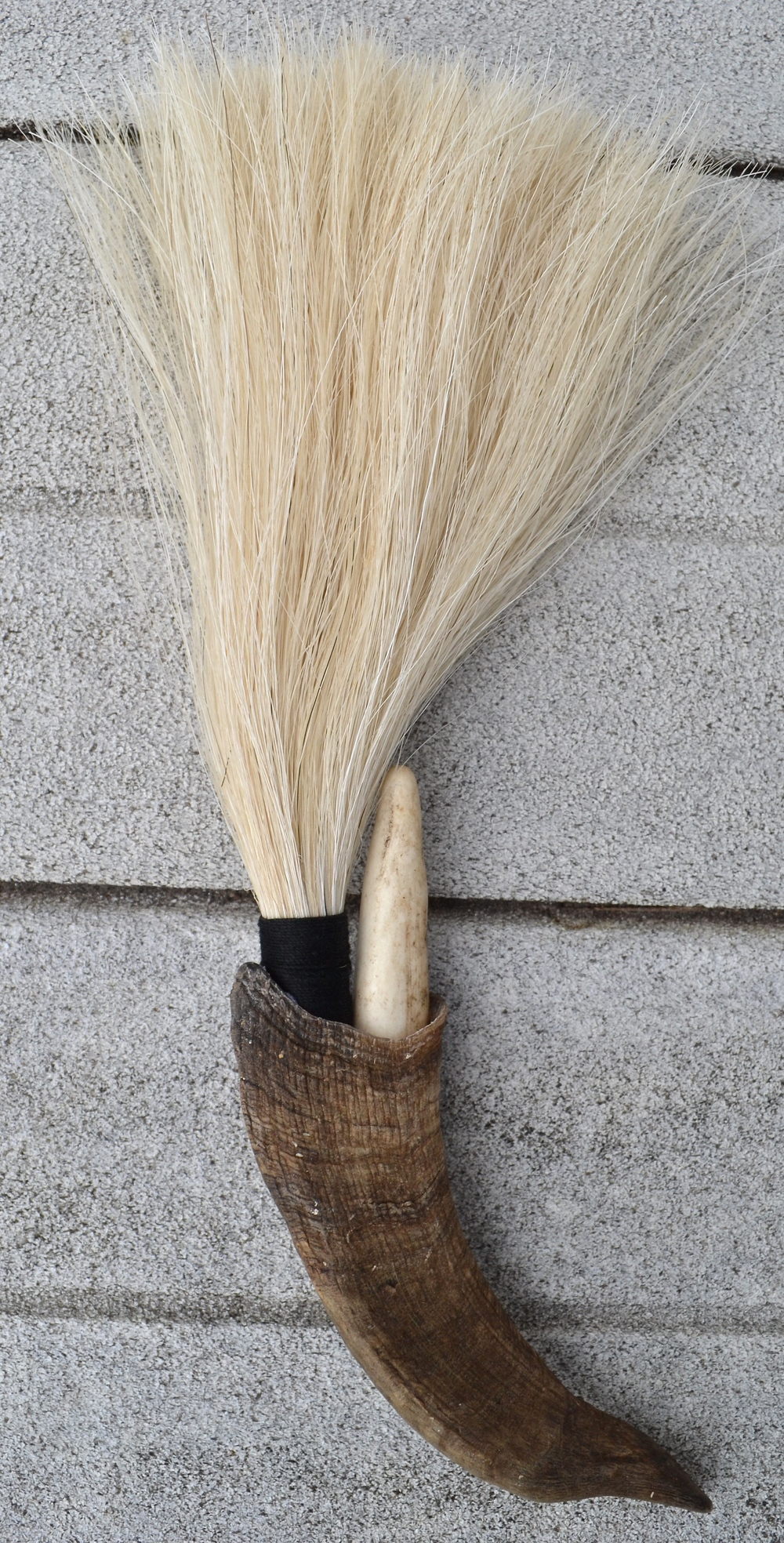 Goat horn, horse hair, twine, and anger tip  Artist made primal brush for use or display