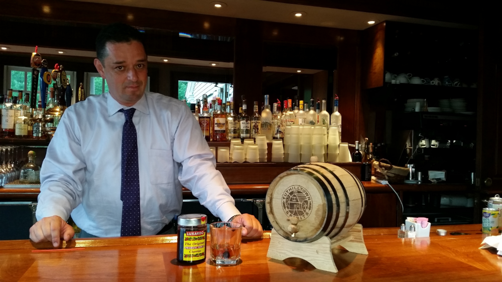 J.C. Mejia with Aspetuck Valley Country Club's house-aged bourbon cask and cocktail