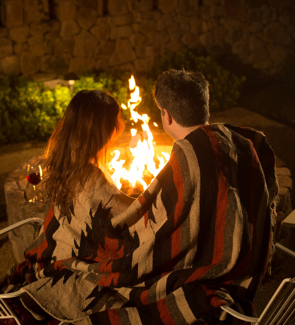 Making s'mores by the fireplace at Farmhouse Inn.  Photography by Nathan Rose Photography