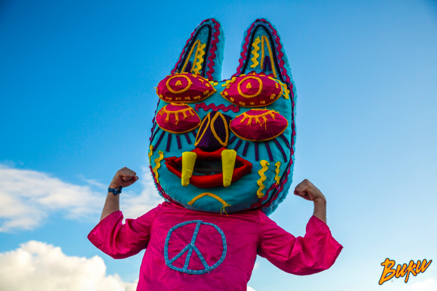One of Buku's four taboo inspired characters that may be seen on the festival grounds. While their apparel varies, the characters will often wear the same hat or mask.