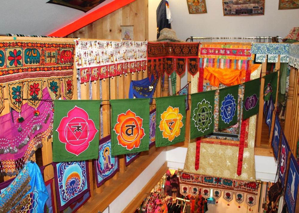 Various door threshold covers from Nepal, belly dancing scarves from India, and batik-dyed flags from Bali, Indonesia decorate the second story of Juliet's Jewels.