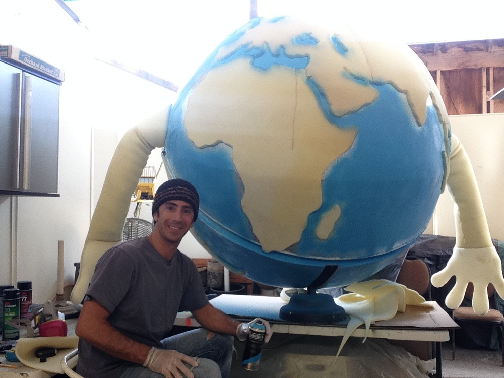 Matthew McAvene Paints 6' Earth Day Puppet.JPG