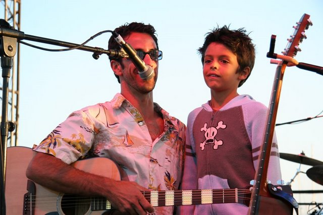 Matthew McAvene with son Ben Catch McAvene on stage at West Beach Festival.JPG