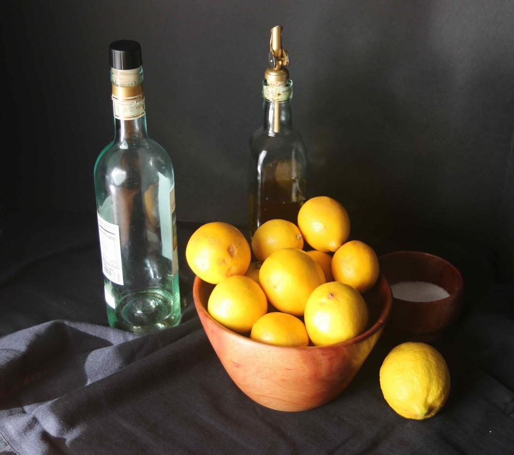 Meyer lemons in a bowl, Eureka lemon on the sides