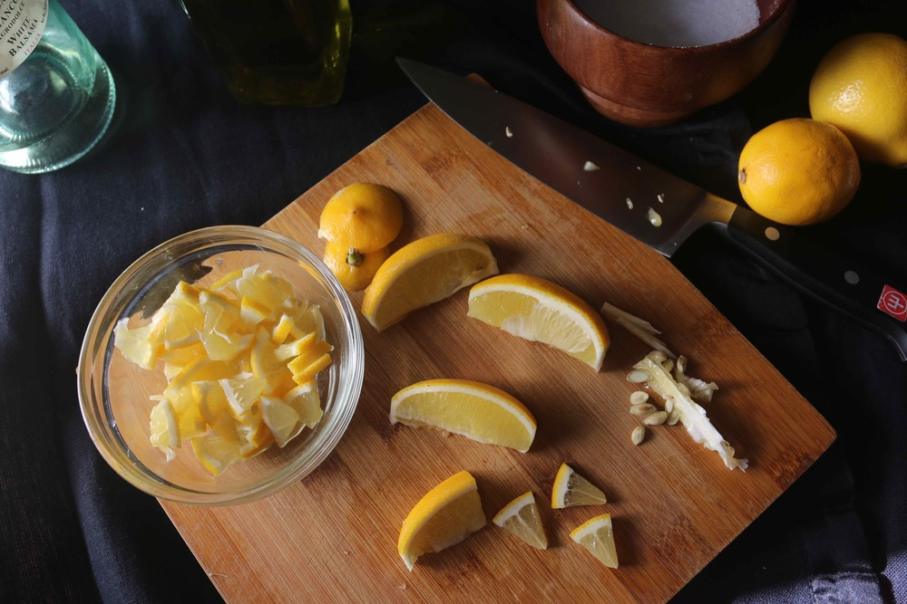 Thinly slice each of the 8 Meyer lemon wedges.