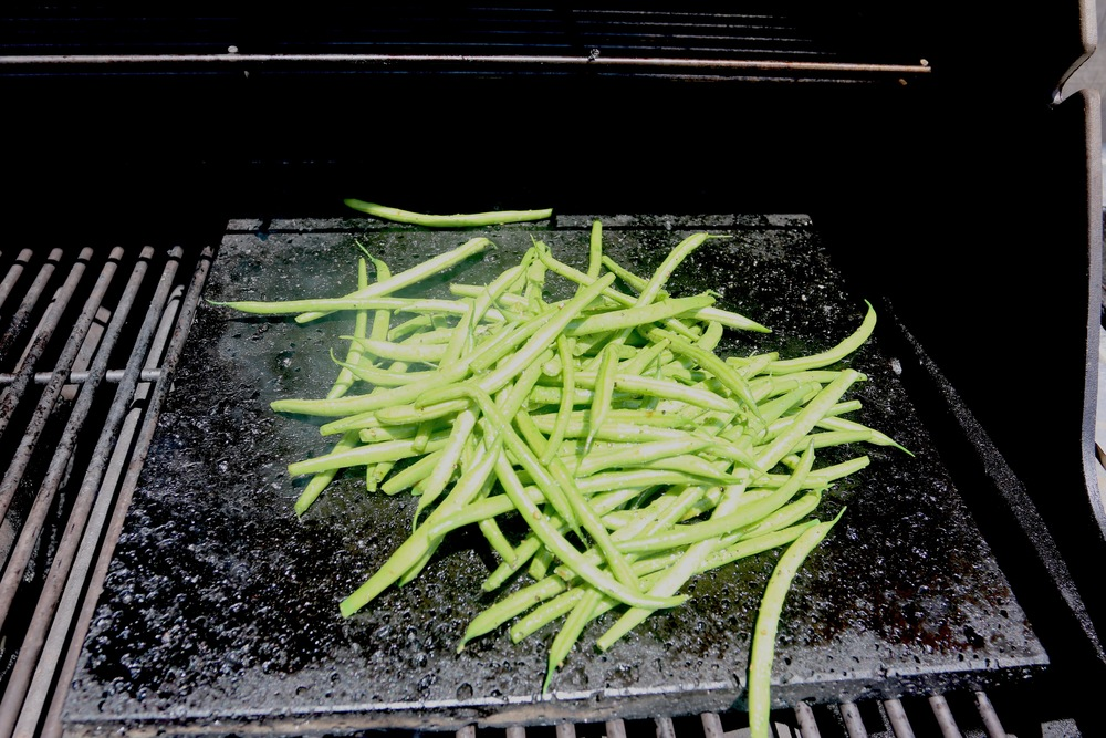Grilling and charring green beans
